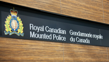 sign reading Royal Canadian Mounted Police in english and french